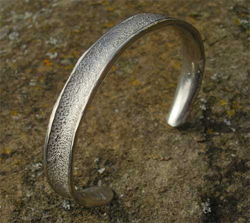Women's contemporary torc bracelet