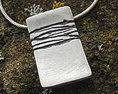 Womens etched silver designer necklace