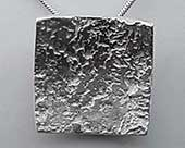 Womens rocky texture silver pendant