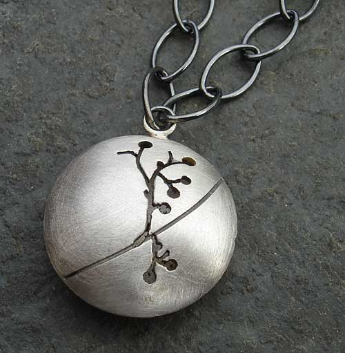 Women's silver etched pendant