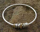 Womens unique gold and silver bangle
