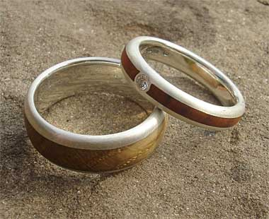 Wooden wedding ring and wooden engagement ring